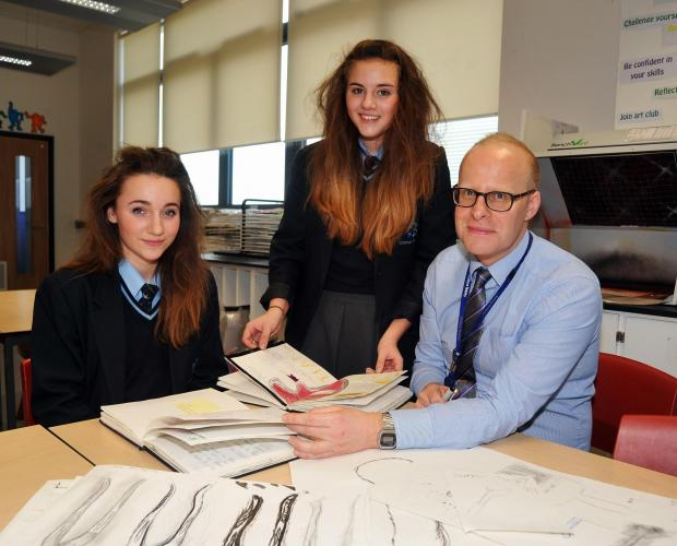 Art team leader Gareth Luxton with Year Nine students Beth Manchip (left) and Rachel Rowland. Photo: Jeff Searle.