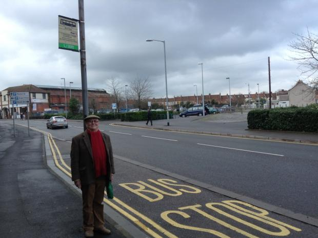 Bus user Michael Carpenter criticises cuts to First Bus services. (This bus stop is not included in the cuts).