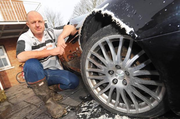 Bridgwater Mercury: Royston Grimstead with his prized Aston Martin after Luce attacked it.