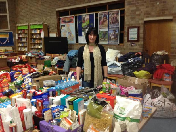 Lucy Richards surrounded by the many donations provided by people from Somerset and beyond at the rest centre in Westfield Church