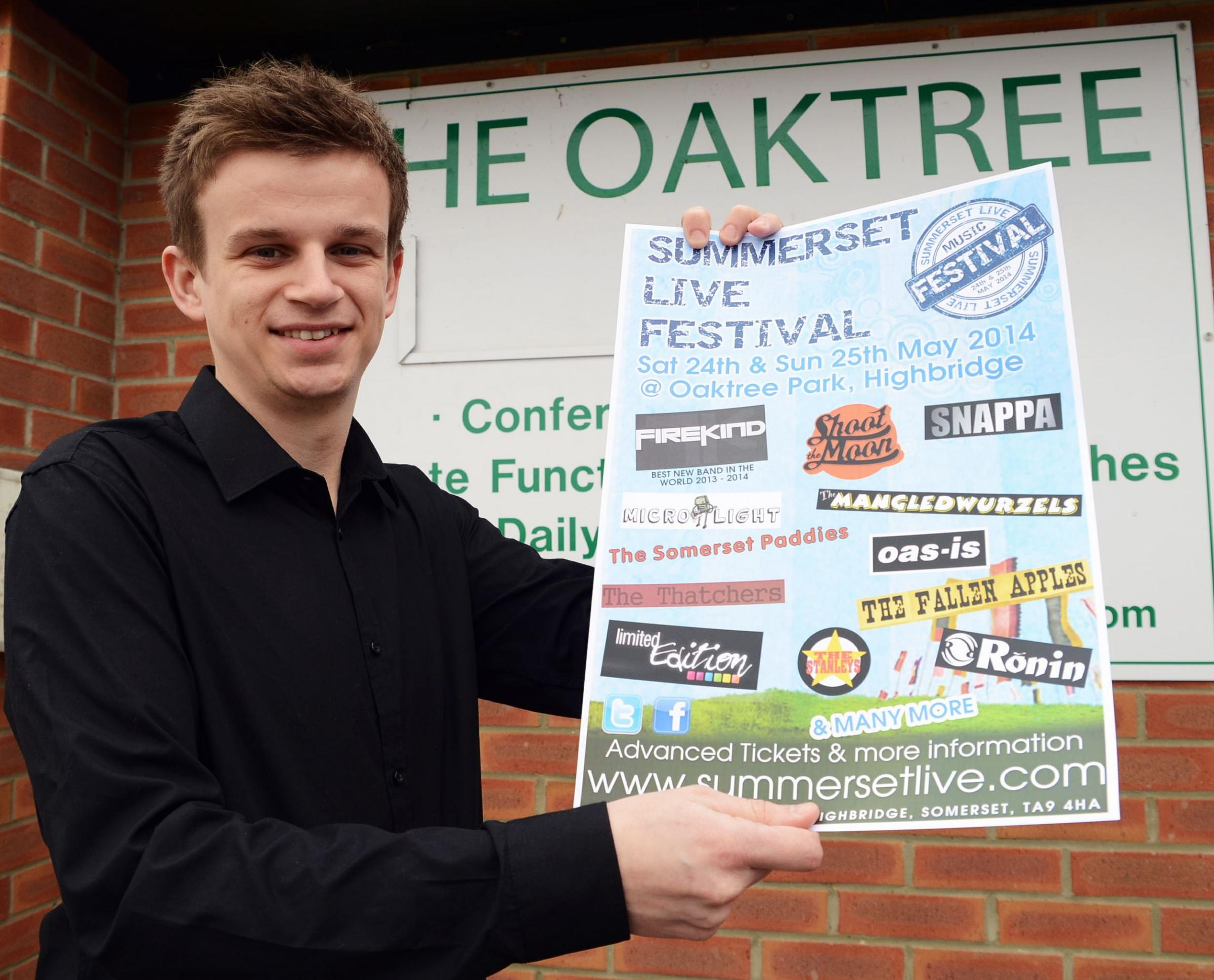 Jordan Jones, festival organiser, with the festival poster outside the Oaktree