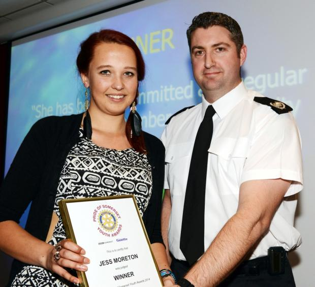 JESS Moreton receives her award from Gavin Ellis, of sponsors Devon and Somerset Fire and Rescue Service.