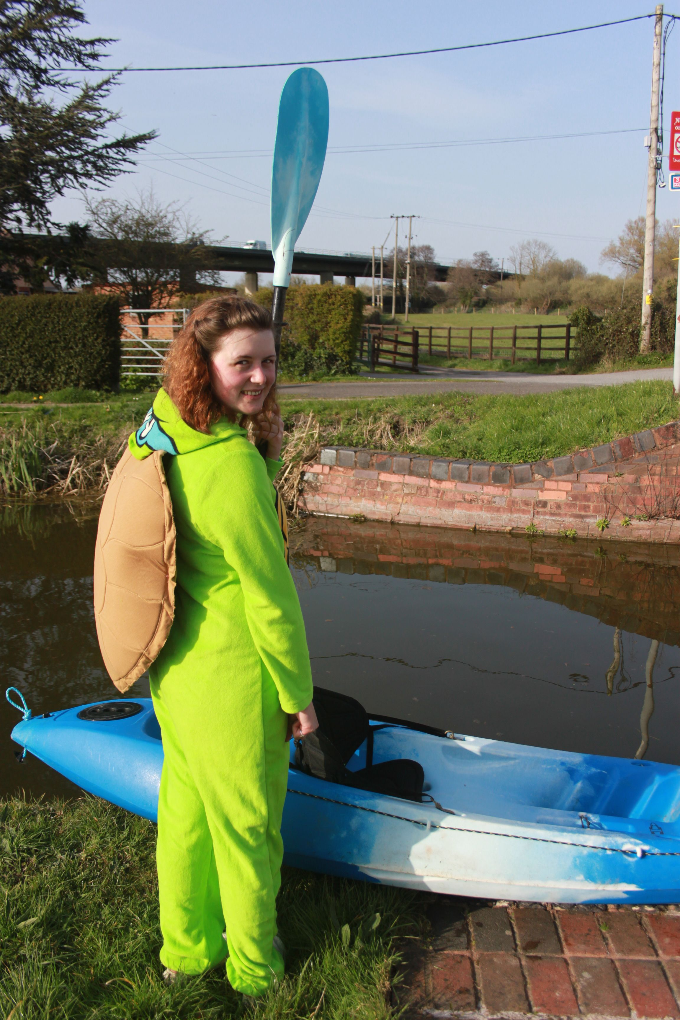 Emily Easman, 19, in costume as she prepares to kayak down the canal