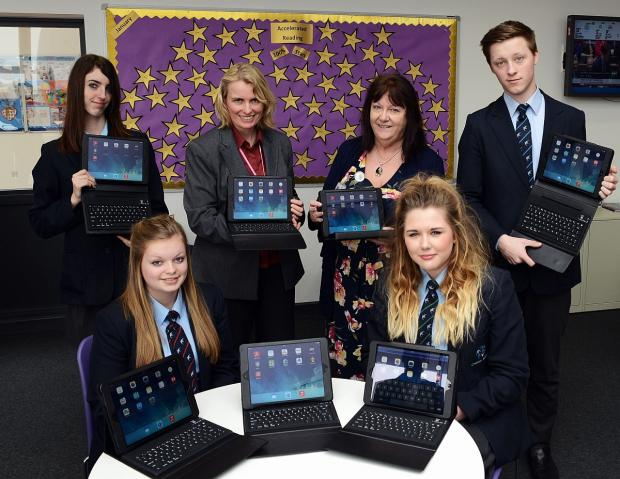 Georgia Heal 15, Samantha Platt 16, front, and Jodie Patten 16, Caroline Matthews, Stella Preece and Joe Taylor 16 with the new iPad laptops.