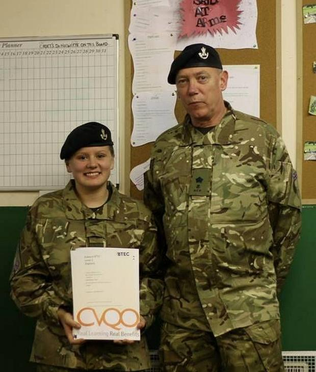 Bridgwater Mercury: Cadet Shannon Came receives her BTEC certificate from adult instructor Major Trunks at Cannington Platoon.