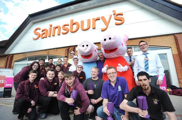 Staff at Sainsbury's with Crusaders Carnival Club members plus Peppa Pig and George.