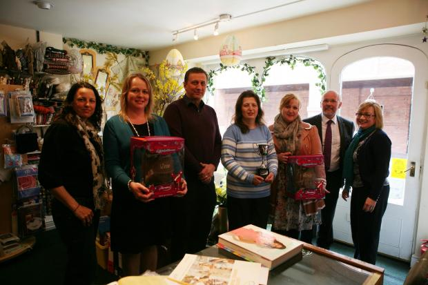 The winners of the Easter window displays are awarded their prizes by members of the Bridgwater Town Team.