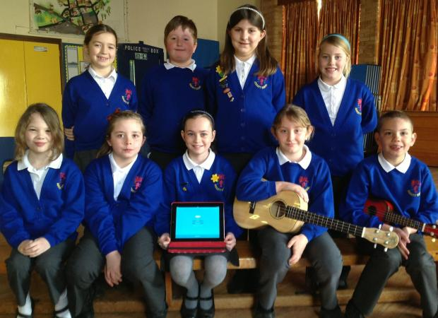 The children at Ashcott Primary School with a laptop where they have been chatting to their Chinese penpals.