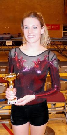 Sophie Churchill shows off her trophy for her performance at the national finals