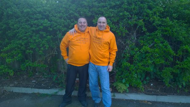 Matthew Eggar and Pete Harvey in their special charity walk hoodies