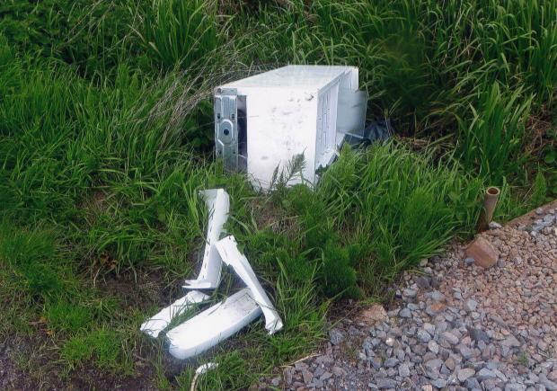 This picture shows fly-tipping of electrical goods in Bull Horn Drove, Westonzoyland