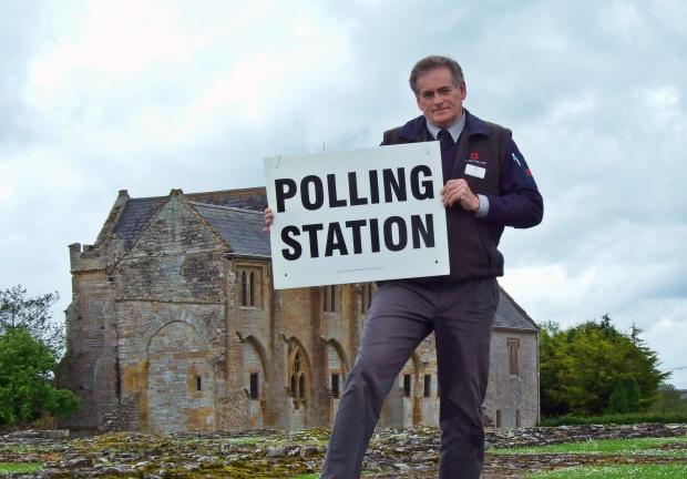 Stephen Honey of English Heritage prepares to open Muchelney Abbey to voters.