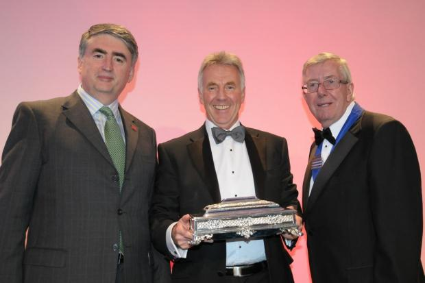 TOM Mullarkey, RoSPA chief executive (left), and Lord McKenzie of Luton, (right), present Magnox managing director Neil Baldwin (centre), with the Sir George Earle Trophy.