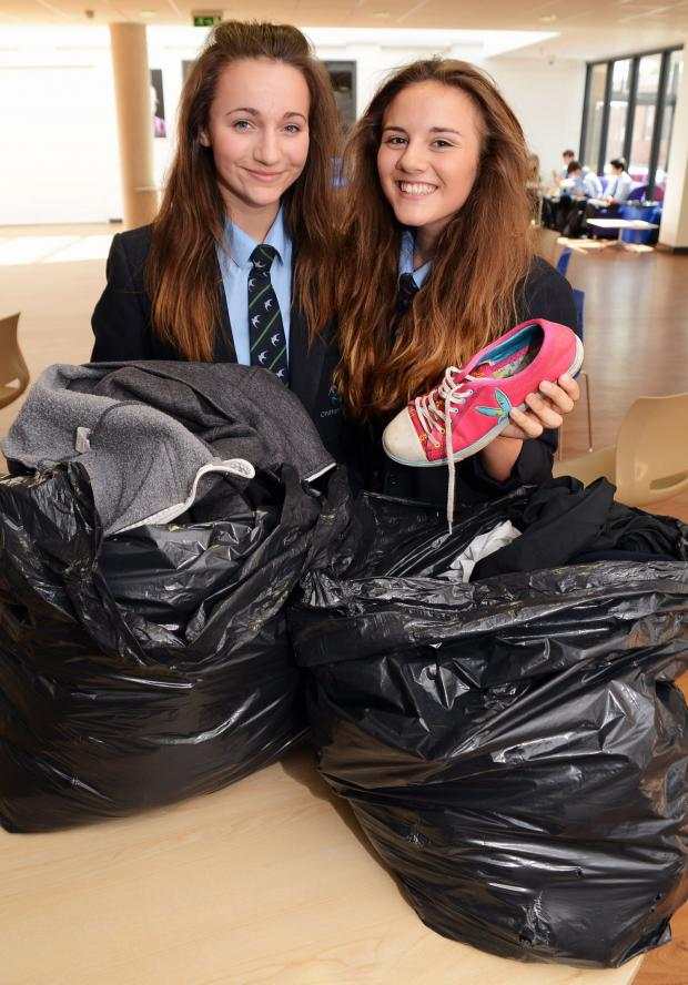 Bridgwater Mercury: MATERIAL GIRLS: Chilton Trinity students are collecting materials to fund a trip to Africa. Above are Beth Manchip and Rachel Rowland, 14. PHOTO: Jeff Searle