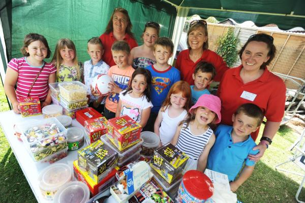 PTFA members and children at the summer fair.