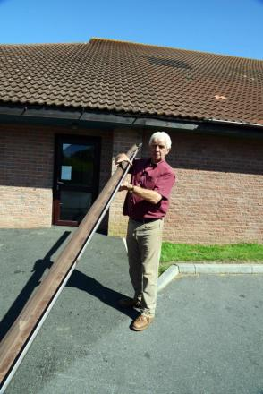 CLLR and North Petherton Mayor Alan Bradford holding damaged drain piping after vandals attacked the community centre.