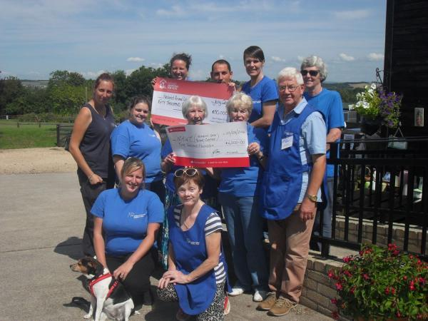 THE team at Heaven's Gate with Bridgwater supporters and their cheques.