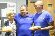 PRE-PIED: Paul James (centre) awaits his fate from pie delivery operatives Margaret Wyatt and Aaron Calder.