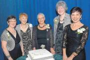 CAROL Rennison, Sheila Bailey, Rosemary Bulled, Pauline Wills and Linda Hocking with the diamond anniversary cake.