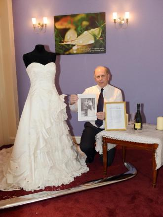 FUNERAL arranger Geoff Parker with the ration bride display at Co-operative Funeralcare in Bridgwater.