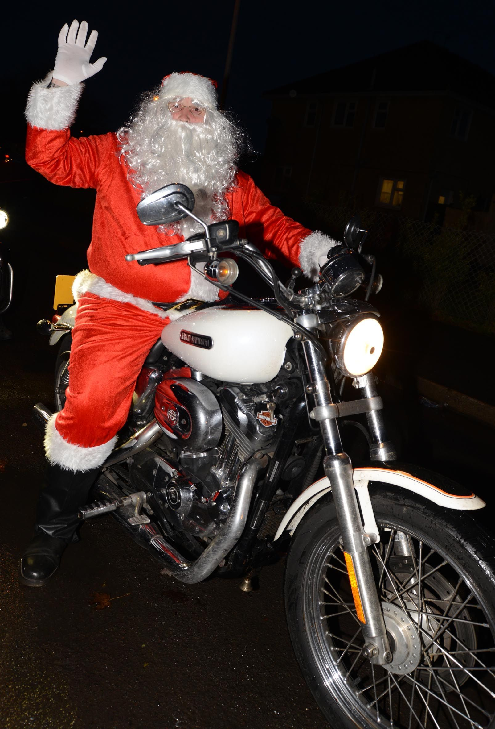 santa arrives on harley-davidson