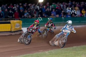 DERBY WIN: Jake Allen powers round Nicolai Klindt to take Heat 2 in Somerset's victory over Poole Pirates in front of a big Bank Holiday crowd on Good Friday. Pic: Colin Burnett