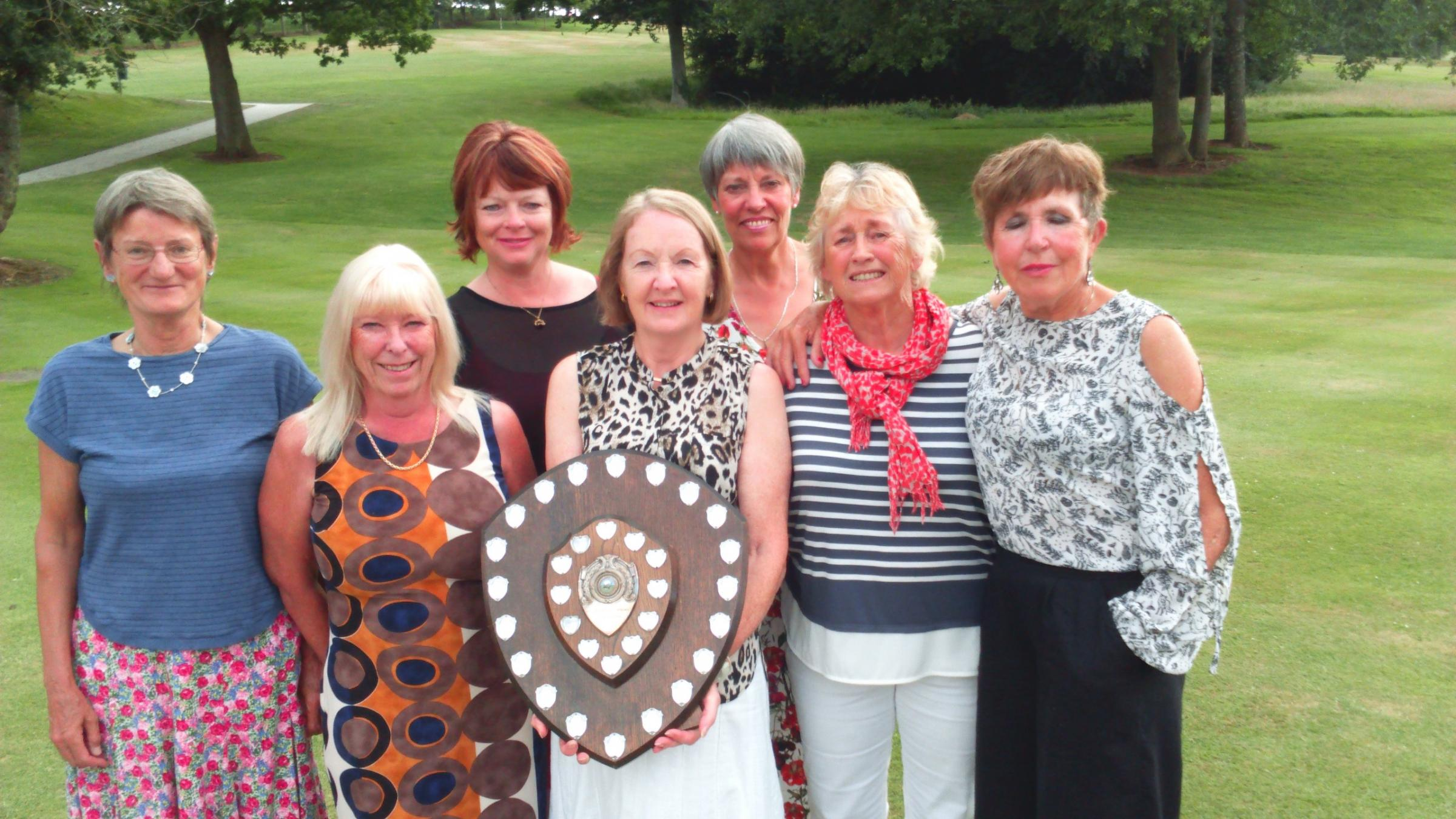 WINNERS: Enmore Park Ladies (from left): Judy Hancock, Sarah Blake, Shanni Whisler, Lady Captain Linda Anniss with the trophy, Sally Dymock, Eve Bolton and Pat Rodgers.