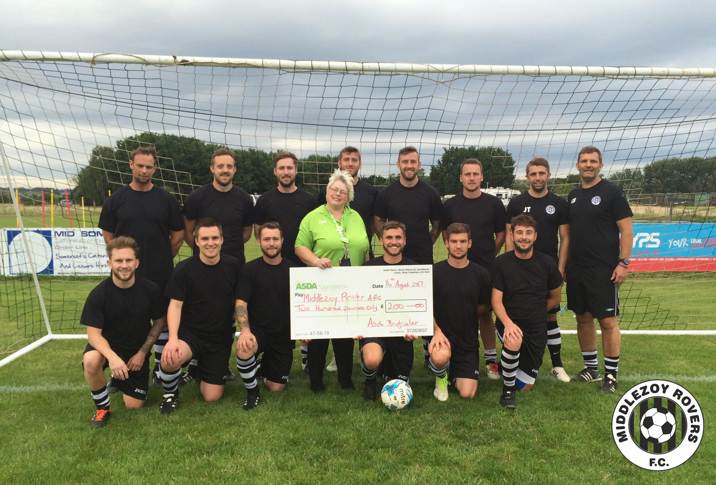 BOOST: Middlezoy Rovers FC receive a £200 cheque from Asda community champion Joanne Thexton, ahead of their match against Staplegrove.