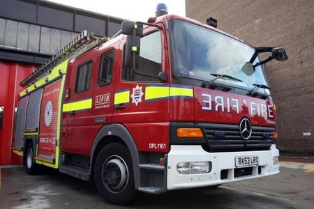 FREED: A man has been freed by firefighters after being trapped in a toilet cubicle