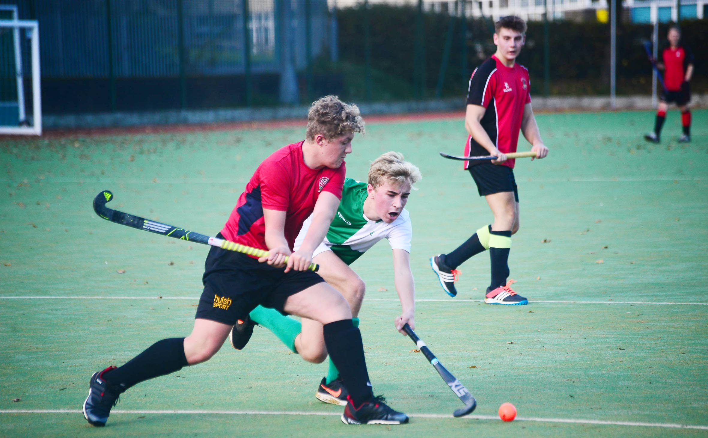 STRIKE: Sam Steadman (red kit) in action for Bridgwater men's fourths. Pic: Steve Richardson