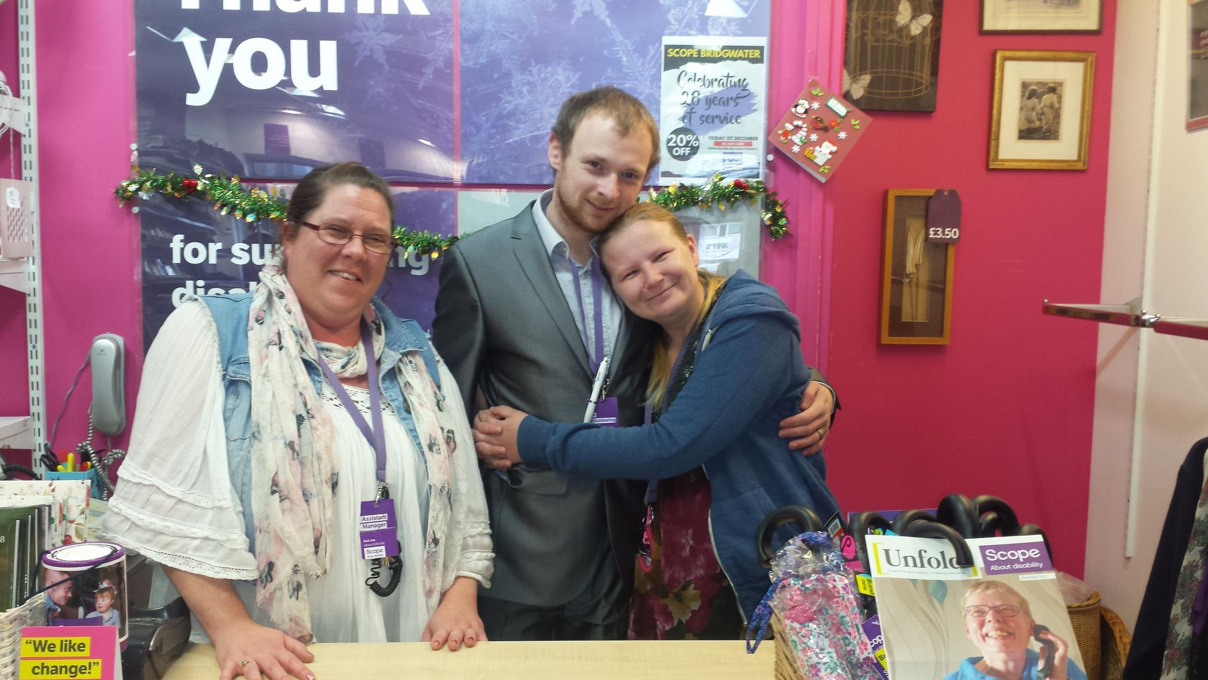 HAPPY COUPLE: Kylie and Shanahan with shop assistant manager Michelle Hardy (left)