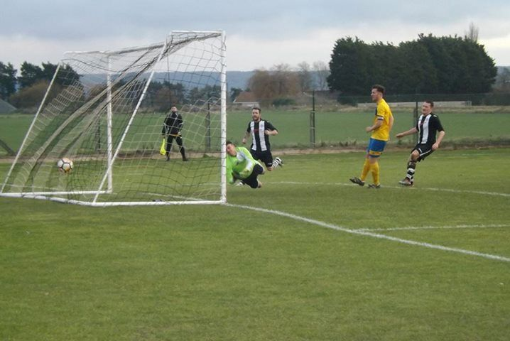OPENER: Callum Laird puts Middlezoy Rovers ahead against Clevedon United.