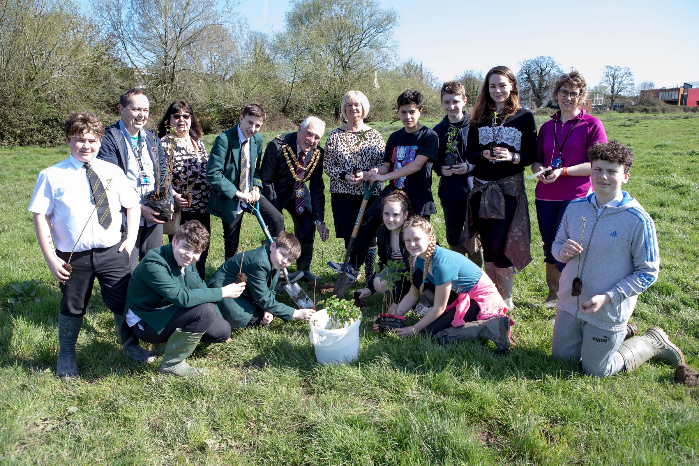 GOING GREEN: The mayor and mayoress join Robert Blake students for the tree planting ceremony (Picture by Les Pickersgill)