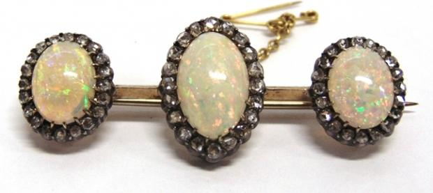 Bridgwater Mercury: BEAUTIFUL BROOCH: A smart opal and diamond triple cluster bar brooch, circa 1900 fetched £1,050