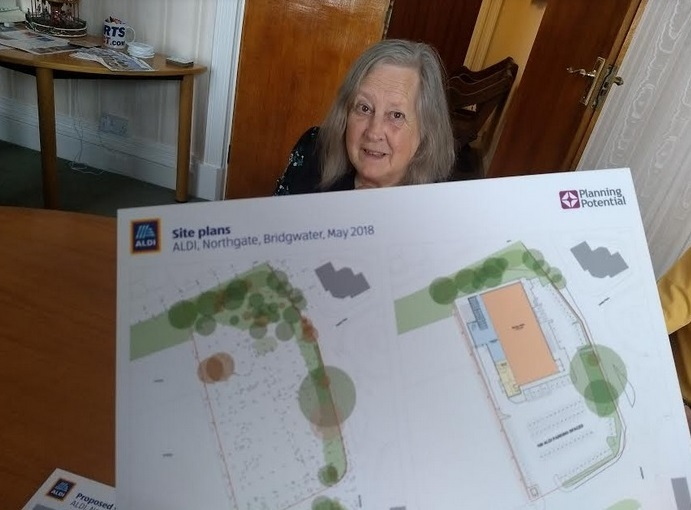 PLANS: Cllr Pat Morley looks over the Aldi proposals