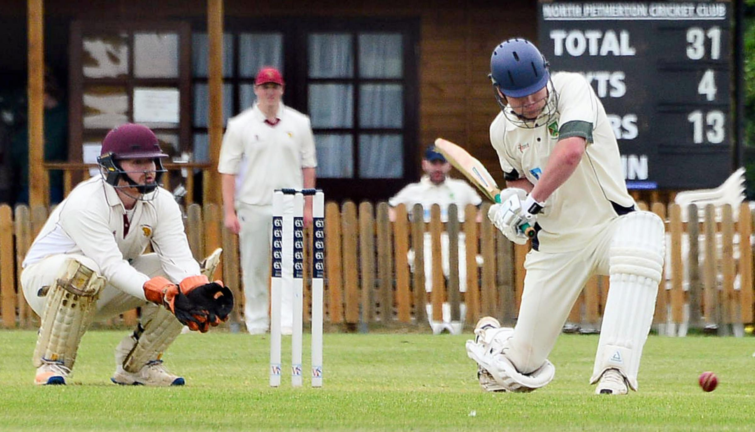 HITTING OUT: North Petherton's Tom Williams in action against North Perrott.