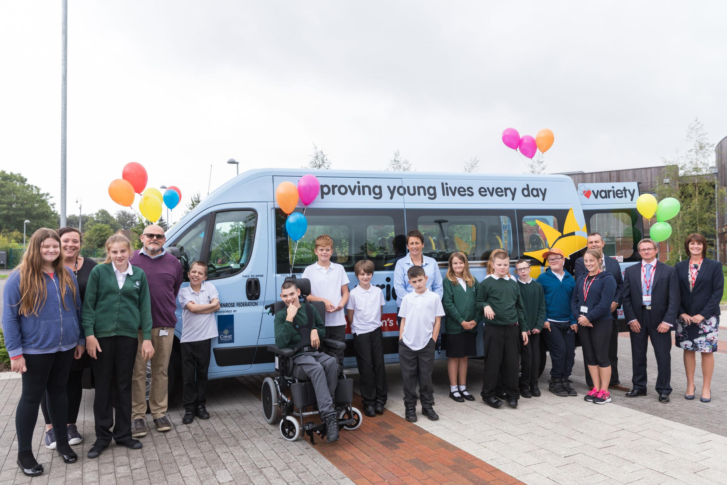 DELIGHTED: Staff, students and representatives from Crest Nicholson and The Variety Club in front of the new bus. Picture by Justin Krause.