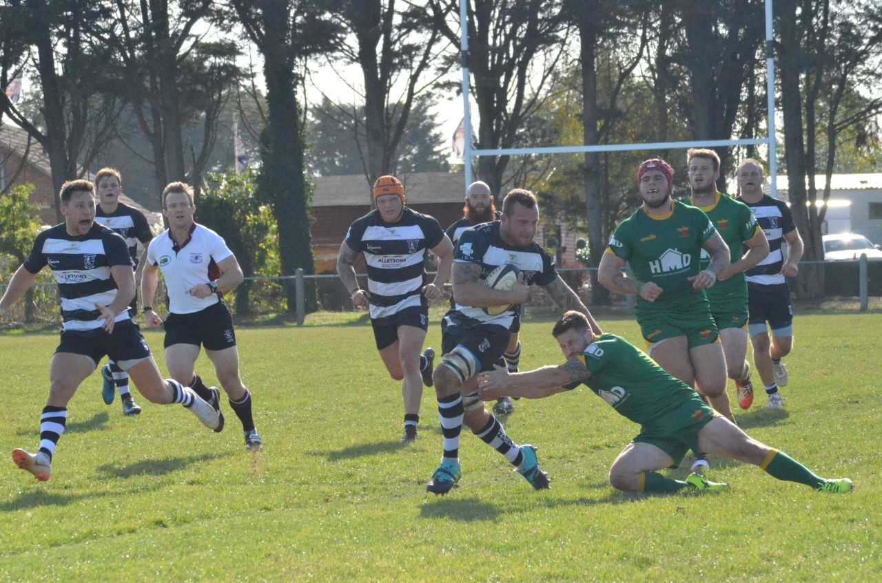 HIGH-SCORING ENCOUNTER: Aiden Cotton en route to the try-line for North Petherton against Newent on Saturday. Pic: Chris Hancock