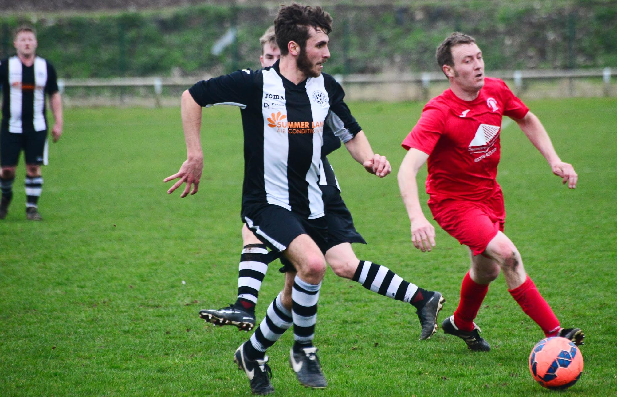 BRACE: Middlezoy's Jed Williams (black/white kit) scored twice at Nailsea United. Pic: Steve Richardson.