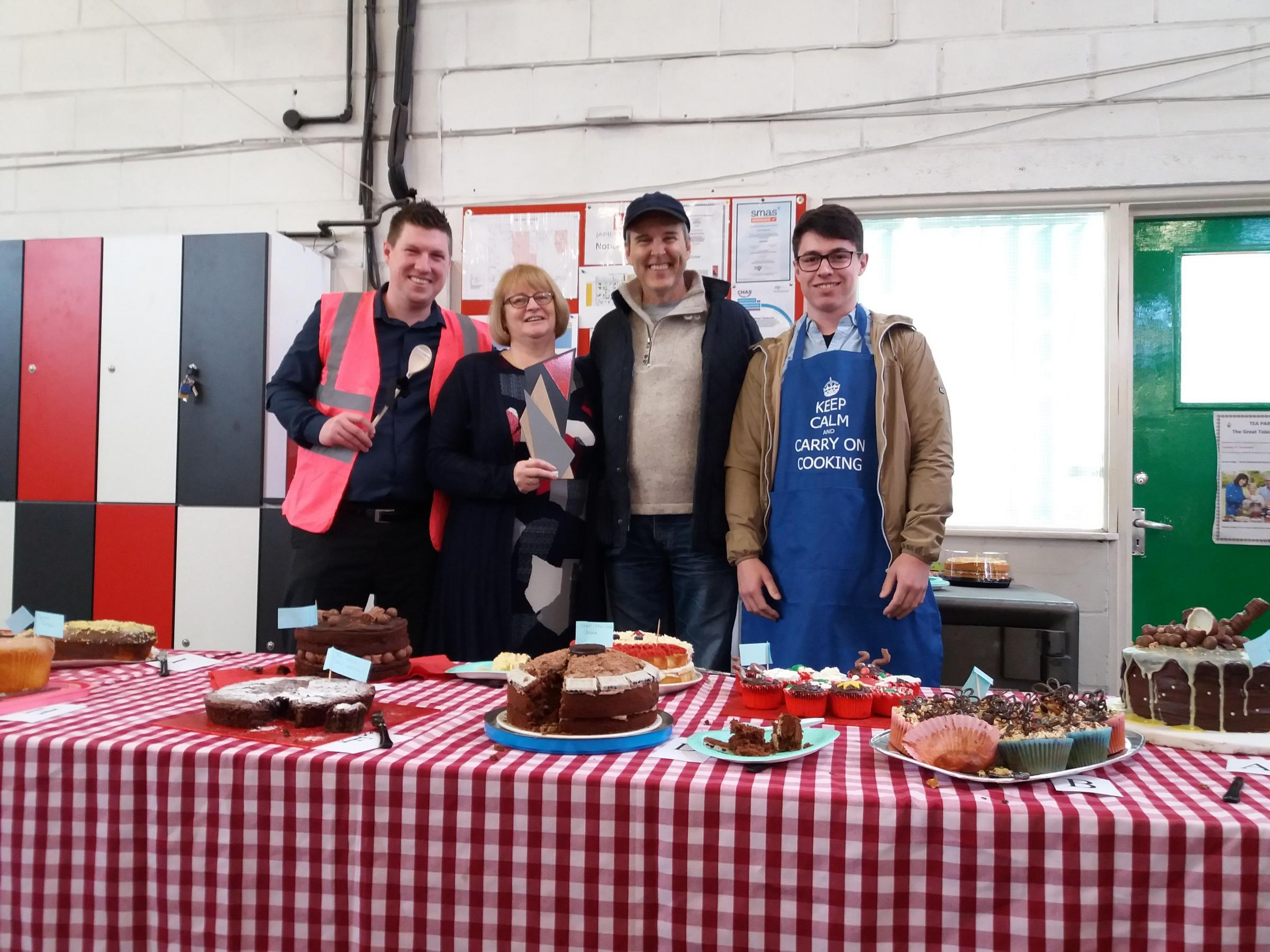 BAKE-OFF: (L-R) Wooden spoon winner Dean Goodall, 1st prize Denise Williams, guest judge Mike Kitch and runner-up Kristian Vearncombe