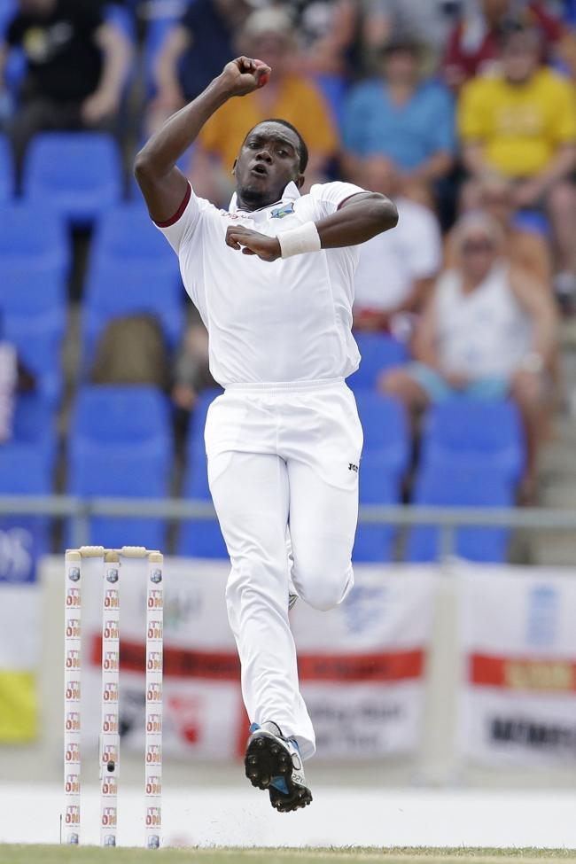 West Indies' Jerome Taylor bowls against England during day four of the first cricket Test match at the Sir Vivian Richards Cricket Ground in Antigua, Antigua and Barbuda, Thursday, April 16, 2015. (AP Photo/Ricardo Mazalan).
