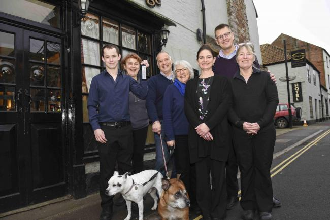 OPEN AGAIN: The Old Vicarage's new owners Peter and Candida Sterling (centre) with members of their team