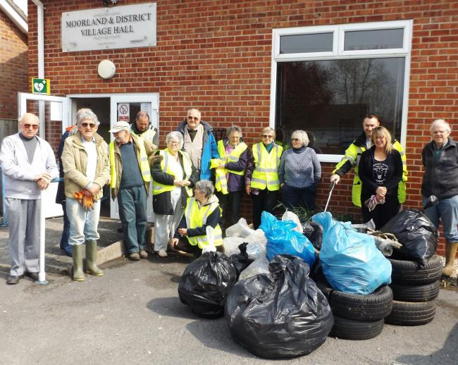 ENTHUSIASTIC: Villagers from Moorland and Fordgate picture outside the Village Hall after collecting 19 bags of rubbish during the annual spring clean event organised by the local garden club