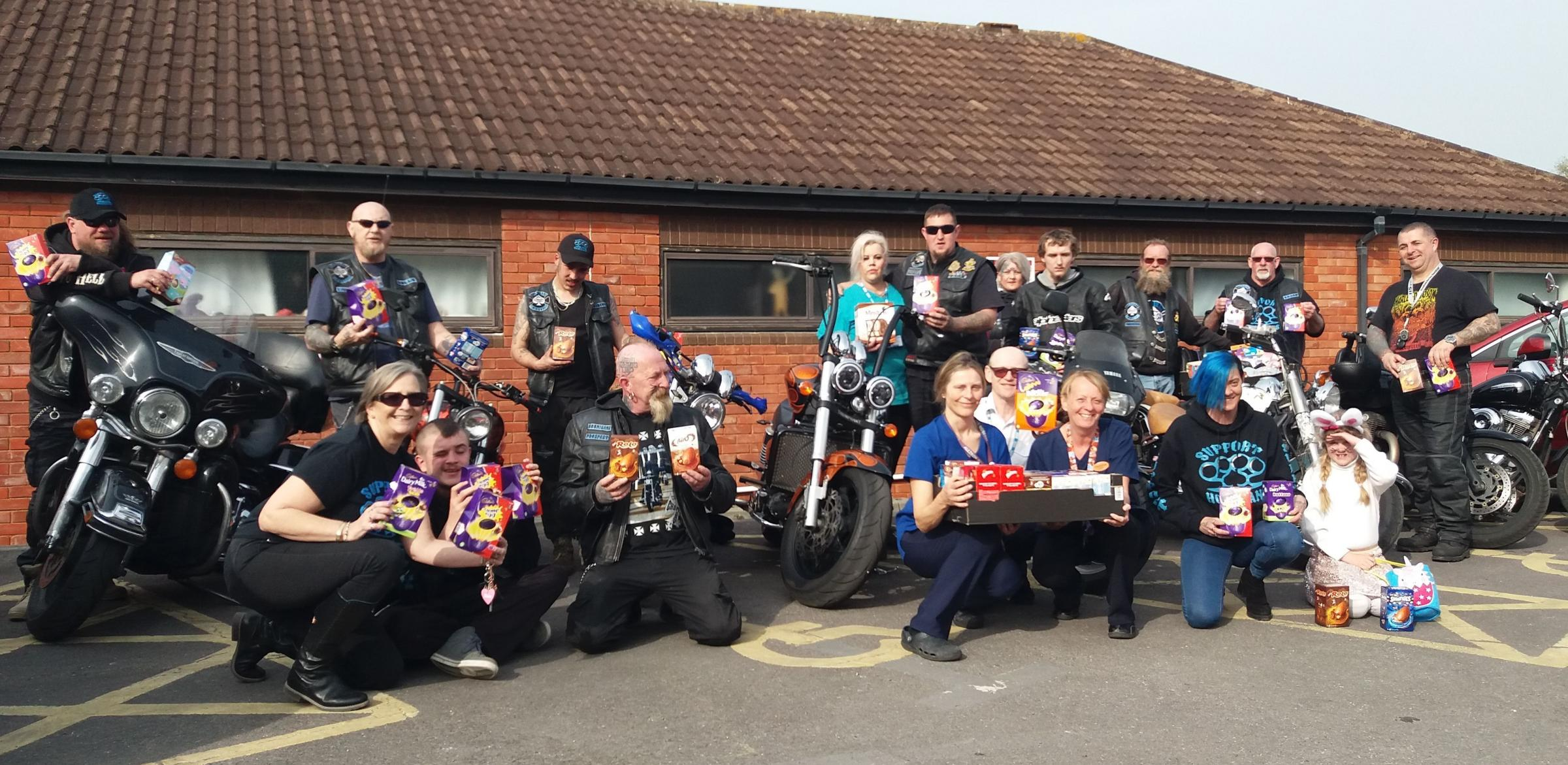 DONATIONS: The Hoonigans Motorcycle Club with NHS staff outside the children's unit