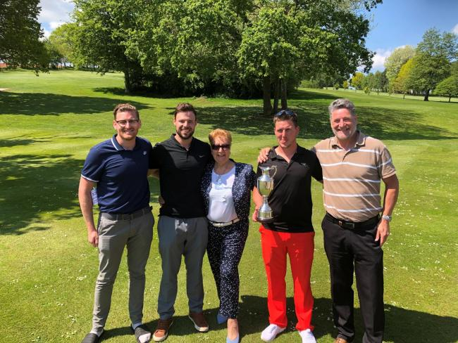 TRIUMPH: Dave Hartley Texas Scramble winners - Alex Clapp and Stuart Chrystall presenting Kay Hartley, Adam Wright and Martyn Clapp with the trophy